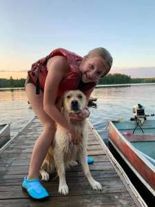 Me and one of my appreciative Humans on the dock at Northwind Lodge, Ely MN